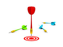 Red Arrow with Target. Red winner dart arrow on target with loser ones, isolated on white background Royalty Free Stock Photo