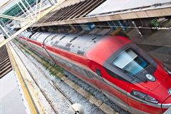 Red Arrow train at Rome Termini station. Top view with rails and royalty free stock photography