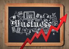 Red arrow and white business doodles against chalkboard and wall Stock Photo