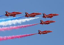 Red Arrows. A shot of 5 Red Arrows on the RAF performing a flypast Royalty Free Stock Images