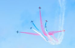 Red Arrows. In flight with trailing smoke Royalty Free Stock Photo