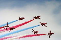 Red arrows aeorobatic display team. Red arrows aeorobatic display at raf fairford Royalty Free Stock Images