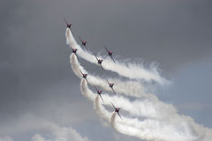 Red Arrows aerobatic display team. In formation, Swansea, South Wales royalty free stock photo