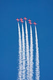 Red Arrows Aerobatics. A brilliant performance against a beautiful blue sky of the Royal Air Force Aerobatics team the Red Arrows Royalty Free Stock Photo