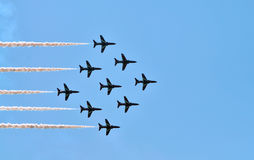 Red Arrows Air Show. The RAF Red Arrows aerobatic team flying in formation Royalty Free Stock Photography