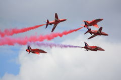 Red Arrows breaking formation Stock Images