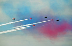 Red arrows in coloured smoke. Photo of the red arrows in red white and blue smoke performing at herne bay airshow kent on 14th august 2016 ideal for aeroplanes Stock Photo