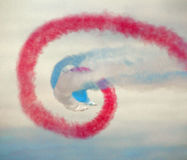 Red arrows contrail swirl Royalty Free Stock Photography