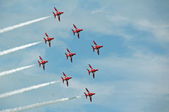 Red arrows and contrails Stock Images