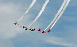 Red arrows and contrails Stock Photography
