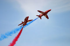 Red Arrows display RAF Fairford. BAE hawk fast jet Royal Air Force Aerobatic Team Royalty Free Stock Photo