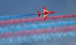 Red Arrows display team. British R.A.F Red Arrows display team jet and smoke trails stock photo