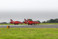 Red arrows display team. Red arrows taking off on runway in formation Royalty Free Stock Photos