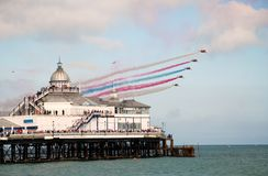 The Red Arrows, Eastbourne. Royal Air Force display team The Red Arrows perform over the Victorian pier at an airshow on August 16, 2009 in Eastbourne, England Stock Images