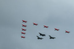 Red Arrows, Eurofighter Typhoon, and F-35 Lightning 2 Royalty Free Stock Images