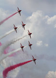 Red Arrows in flight Stock Photo
