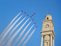 Red arrows fly over clock tower. Photo of red arrows team flying over clock tower at herne bay airshow 14th august 2016 ideal for aeroplanes,jets,airshows etc Royalty Free Stock Photography