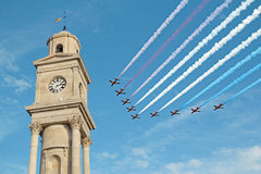 Red arrows flyby clock tower Royalty Free Stock Images