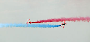 Red arrows flyby crossover Royalty Free Stock Photos