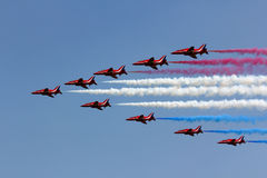 Red arrows. Flying display with smoke Royalty Free Stock Image
