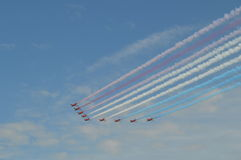Red arrows. Flying to the left with flag colours Royalty Free Stock Photography