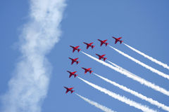 Red Arrows formation. Flying against a blue sky royalty free stock images