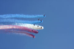 Red Arrows formation flying. Against a blue sky stock photos