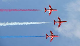 Red arrows formation flying royalty free stock photography