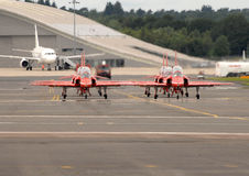 Red Arrows in the jet haze Royalty Free Stock Image