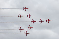 The Red Arrows. Officially known as the Royal Air Force Aerobatic Team, is the aerobatics display team of the Royal Air Force based at RAF Scampton Stock Photography