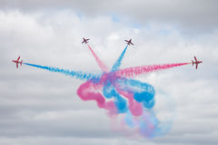 The Red Arrows. Officially known as the Royal Air Force Aerobatic Team, is the aerobatics display team of the Royal Air Force based at RAF Scampton royalty free stock images
