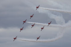 The Red Arrows. Officially known as the Royal Air Force Aerobatic Team, is the aerobatics display team of the Royal Air Force based at RAF Scampton Stock Photo