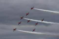 The Red Arrows. Officially known as the Royal Air Force Aerobatic Team, is the aerobatics display team of the Royal Air Force based at RAF Scampton Royalty Free Stock Photo