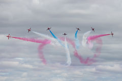 The Red Arrows. Officially known as the Royal Air Force Aerobatic Team, is the aerobatics display team of the Royal Air Force based at RAF Scampton Stock Photos