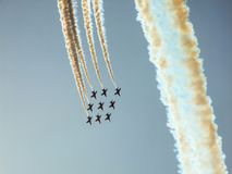 Hawk jet aircraft aerobatic team. Red Arrows over Polish sky. Hawk training aircraft in diamond formation making a loop during Radom Air show in Poland in 2010 Royalty Free Stock Photo