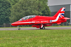 Red Arrows Pilot. Flight of the RAF Red Arrows team preparing for takeoff Stock Photo