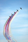 The Red Arrows RAF Airforce jet aeroplanes. The Red Arrows RAF Airforce aerobatic, formation flying jet aircraft in a blue sky with smoke trails Stock Photo