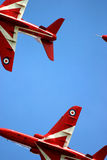 Red arrows at RAF Fairford air tattoo. Red Arrows display RAF Fairford BAE hawk fast jet Royal Air Force Aerobatic Team close up Royalty Free Stock Images