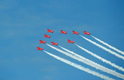 Red arrows smoking contrail stunts royalty free stock image