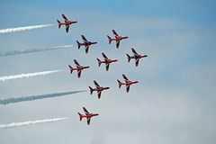 Red arrows stunts. Photo of the red arrows team performing stunts over the skies of herne bay in kent for 2016 annual airshow on 14th august ideal for red arrows Royalty Free Stock Image