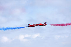 Red Arrows synchro pair. Captured at passing point royalty free stock photo
