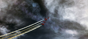 Red Arrows. Taken at the Eastbourne Airshow (UK) in 2013. The day started off foggy with low cloud but eventually the clouds gave way to sunshine and the red Stock Photo
