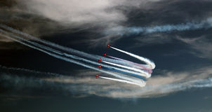 Red Arrows. Taken at the Eastbourne Airshow (UK) in 2013. The day started off foggy with low cloud but eventually the clouds gave way to sunshine and the red Royalty Free Stock Image