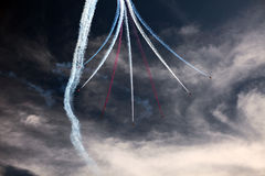Red Arrows. Taken at the Eastbourne Airshow (UK) in 2013. The day started off foggy with low cloud but eventually the clouds gave way to sunshine and the red Stock Photos