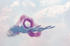 Red Arrows team demonstrates Infinity Break Stock Images