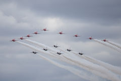 Red Arrows and Thunderbirds form up in a flypast. Stock Photos