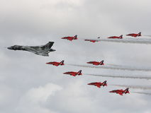 Red Arrows and Vulcan Bomber. The Red Arrows and the Vulcan Bombers flying together royalty free stock images