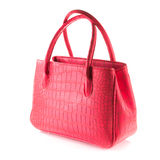 Red artificial crocodile leather bag Stock Photography