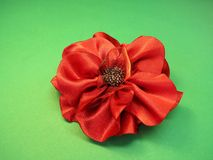 Red artificial fabric flower Royalty Free Stock Image