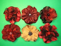 Red artificial fabric flowers Stock Images